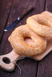 Bagels with sesame seeds. On wood royalty free stock photography