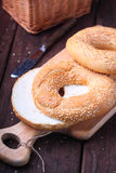 Bagels with sesame seeds. On wood stock photos