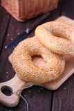 Bagels with sesame seeds. On wood royalty free stock photos