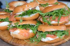 Bagels with Smoked Salmon, Cream Cheese and Rocket. For sale on a market stall Stock Images