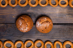 Bagels and two cupcakes Royalty Free Stock Images