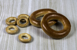 Bagels. Two large  and five small bagels on wood background Stock Images