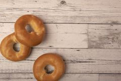Bagels on a wooden background. With copy space stock images