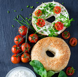 Bagels wtih cream cheese, tomatoes and chives for healthy snack Royalty Free Stock Photo