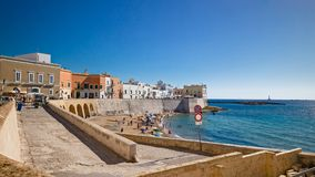 Bagers sunbathe in the beach of purity, in the historic center o. F Gallipoli Stock Photos