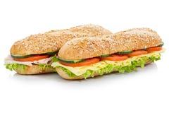Bagettsubsmörgåsar skinka och ost som isoleras på vit royaltyfri foto