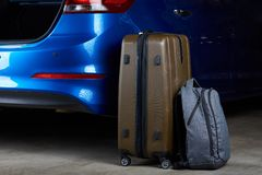 Baggage bags loading to car trunk Stock Image