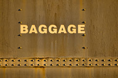 Baggage cabin. Detail of vintage train baggage cabin with inscription and bolts under strong natural light royalty free stock photos
