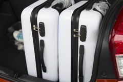 Baggage in car trunk for traveling concept Stock Photos