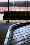 Baggage carousal with seats. In an airport terminal Stock Photos