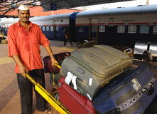 Baggage carrier at the Mumbai Railway station Royalty Free Stock Image