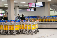 Baggage carts at Schiphol Airport, Amsterdam, Netherlands. Royalty Free Stock Image