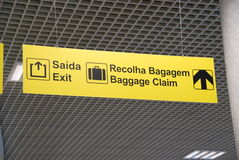 Baggage claim. Yellow exit and baggage claim sign at a international airport (hanging on a ceiling Royalty Free Stock Photo