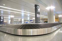 Baggage claim. Baggage carousel at the airport. Baggage claim in Shanghai airport Stock Photos