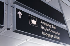 Baggage Claim. A airport baggage claim sign with suitcase luggage and directional arrow symbols Royalty Free Stock Image
