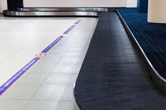 Baggage claim at the airport. Carousel area for passenger waiting for belonging, selective focus royalty free stock photos
