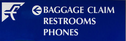 Baggage Claim Airport Sign. A baggage claim, restrooms, and telephone sign directing airport passengers Stock Image