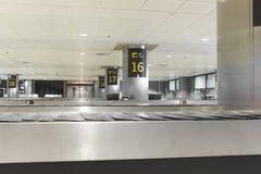 Baggage claim belts area in a modern airport. Nobody Royalty Free Stock Photography