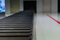 Baggage claim conveyor belt at airport - blurred Stock Photos