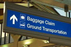 Baggage Claim & Ground Transportation. Typical US airport sign in deep blue Royalty Free Stock Photography