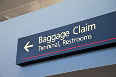 Baggage claim sign. Baggage claim, terminal, restrooms - airport sign with arrow Royalty Free Stock Photo