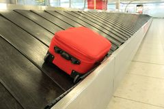 Baggage claim suitcase Luggage convayor belt at airport arrivals Royalty Free Stock Images