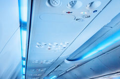 Baggage compartment. Inside an airplane royalty free stock photography