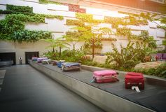 Baggage on conveyer belt in airport.  stock images
