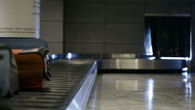Baggage conveyor belt in the airport. Carrying the passenger luggage Shot on Canon 5D Mark II with Prime L Lenses stock video footage
