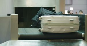 Luggage on a conveyor belt at the airport. Baggage on a conveyor belt at the airport stock video