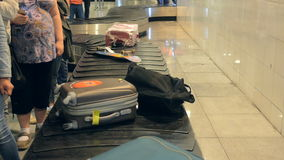 Baggage on conveyor belt at the airport. Selective stock footage