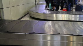 Baggage conveyor. Movement of the conveyor belt baggage stock footage
