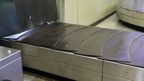 Baggage conveyor. Movement of the conveyor belt baggage stock video footage