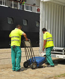 Baggage embarking on the boat, luxury cruise. Two workers loading suitcases of passengers on a luxury cruise ship, port of Seville, Spain Stock Photography