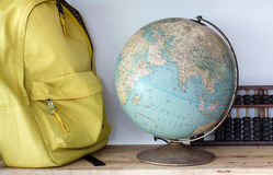 Baggage and globe; abacus Stock Photos