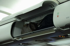 Baggage in overhead locker on aircraft Stock Photography