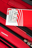 Baggage: Red Suitcase With Airline Ticket On Top Stock Photo