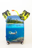 Baggage suitcase with  snorkelling in tropical waters inside. Royalty Free Stock Photos
