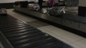 Baggage travels on conveyor belt at the airport. Luggage travels on conveyor belt at the airport stock footage