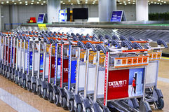 Baggage Trolley Line Up at Beijing Capital Airport PEK Royalty Free Stock Image