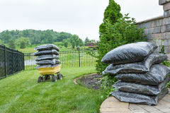 Bagged Mulches on Table and Wagon at the Backyard Stock Photo
