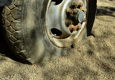 Bagged tires in the sand Stock Photo