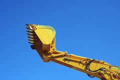 Bagger. Machine against cyan sky Royalty Free Stock Images