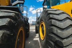 Baggerladermaschine Seitenansicht von Front Hoe Loader Industrielles Fahrzeug Schwere Ausrüstungs-Maschine Pneumatischer LKW Lizenzfreies Stockbild