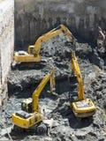 Baggers degli escavatori che scavano ad un cantiere Immagini Stock