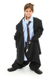Baggy Suit Girl. Adorable seven year old american girl in baggy over-sized suit over white background royalty free stock images