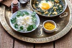 Baghali ghatogh - Iranian dish made with bean, dill, and Eggs. Baghali ghatogh - Iranian dish made with bean, dill, and Eggs Royalty Free Stock Photos