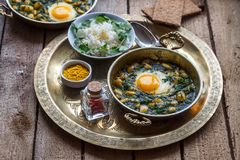 Baghali ghatogh - Iranian dish made with bean, dill, and Eggs. Baghali ghatogh - Iranian dish made with bean, dill, and Eggs Royalty Free Stock Images