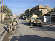 Baghdad Patrol. Two Soldiers return to their Humvee during a patrol in Baghdad Royalty Free Stock Photos