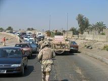 Baghdad Patrol. Two Soldiers patrol a busy Baghdad street Stock Image